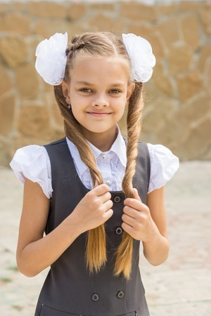 Portrait of a schoolgirl on the holiday September 1 at the school Stock Photo