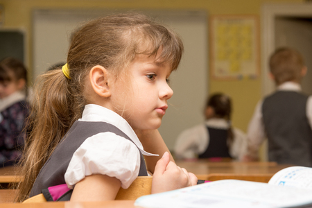 The girl is a first grader at the break in the school class