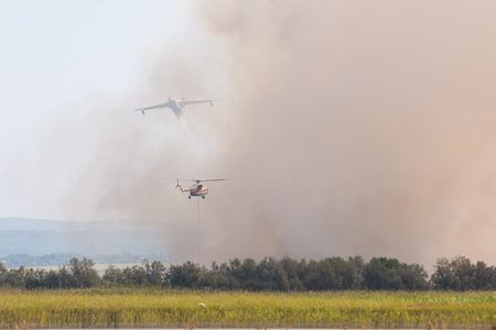 Joint firefighting by airplane and helicopter, on the floodplains of the Anapka River, Anapa, Russia