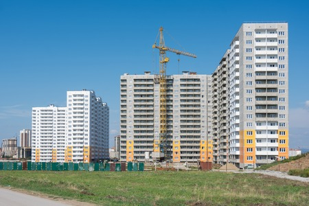 Construction of a residential complex of typical sixteen-storey block houses