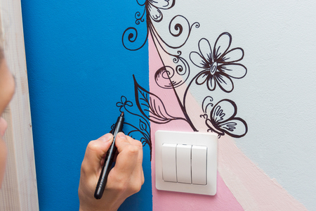 The artist paints the walls of the childrens room pattern Stock Photo