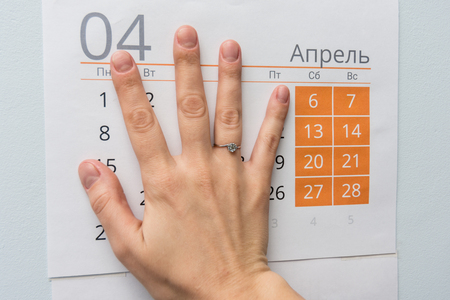 Hand closed weekdays on a sheet of calendar