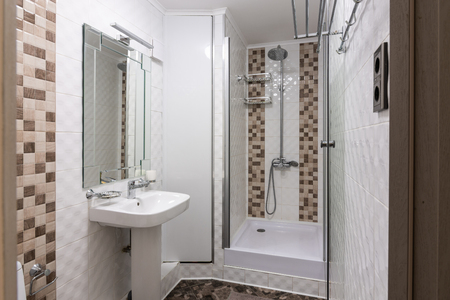 The interior of a small bathroom with shower