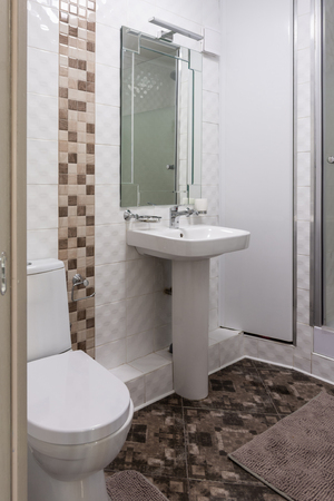 Interior of the combined toilet and bathroom in a small apartment