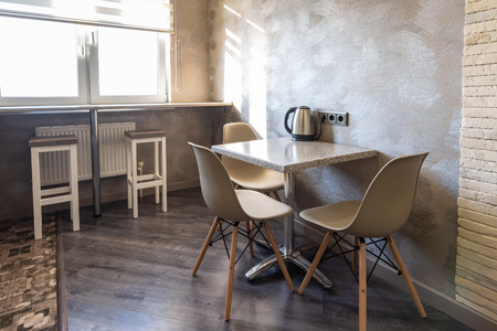 A table with chairs in the interior of the kitchen