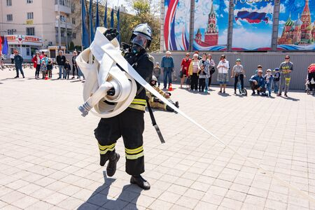 Anapa, Russia - April 27, 2019: Anapa fire-technical exhibition at the Theater Square in Anapa, dedicated to the 370th anniversary of the Russian fire brigade, Demonstration performances of the fire department employee EMERCOM of Russia Editöryel