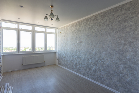 Empty room in the apartment after repair, with a large wide window
