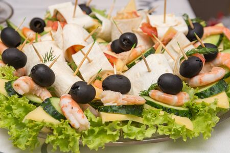 Konope snack on skewers, salad, cheese, shrimp and olive