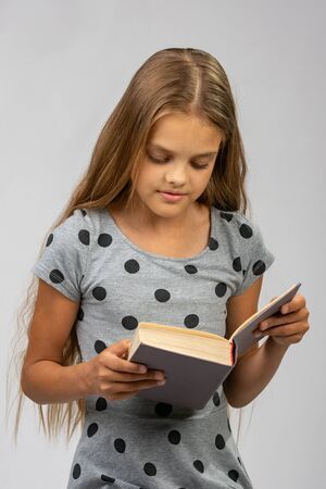 Portrait of a teen girl reading a book