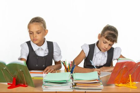 Two schoolgirls at a lesson at the same desk