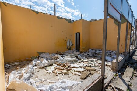 Dismantling of an illegally built store, the rest of the walls, construction waste