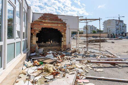 Dismantling pavilions in the market, a half-disassembled furnace of a former cafe