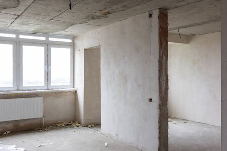 Interior of an empty room without repair in a new building