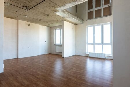 The interior of the spacious apartment without repair, with laminate flooring