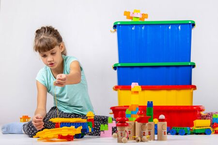 Girl alone plays constructor and other toys Reklamní fotografie