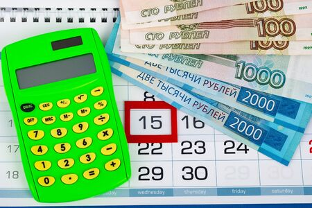 Calendar with a dedicated 15 number, calculator, Russian rubles