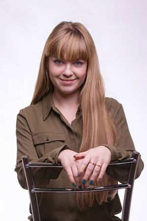 portrait of blonde with hair and bangs on a white background Imagens