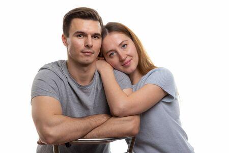 Portrait of a young couple of Europeans, white background Foto de archivo - 139721147