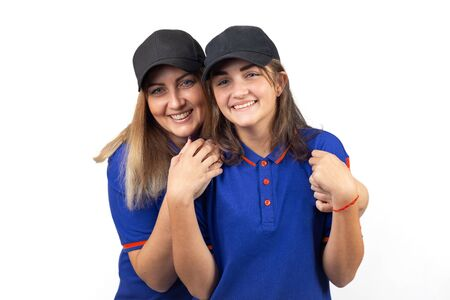 Portrait of two happy women, mother and daughter in blue T-shirts Stockfoto