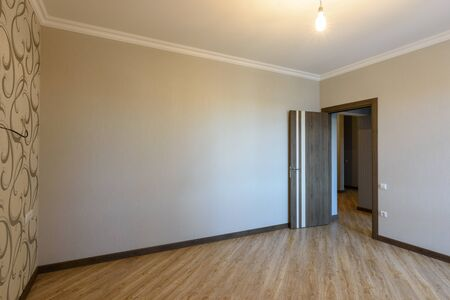 The interior of the empty room, the view of the front door