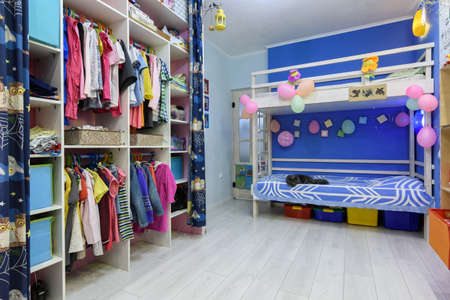 Anapa, Russia - April 2, 2020: The interior of the children's room, with a bed and a large closet