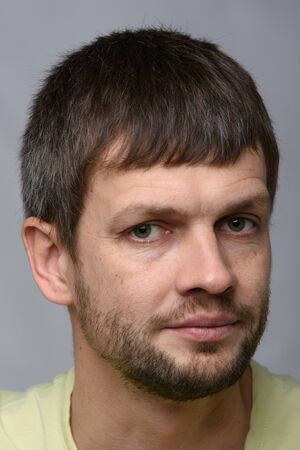 Portrait of a sad man of European appearance, slightly turned his head to the right Фото со стока