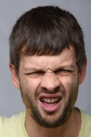 Portrait of a man who smelled, European appearance and close-up Foto de archivo