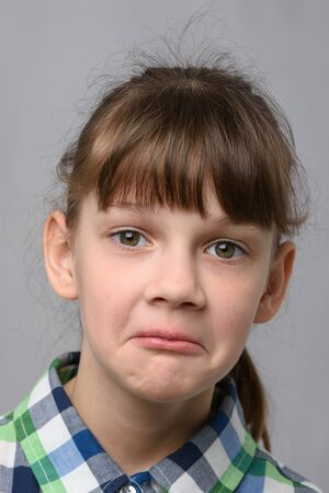 Portrait of a surprised ten year old girl, European appearance, close-up