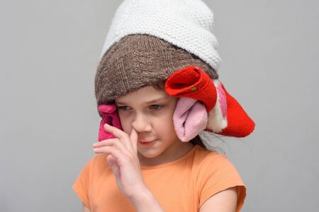 Girl picking her nose with a homemade funny hat