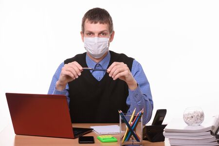 Office worker in protective medical mask on a white background Foto de archivo
