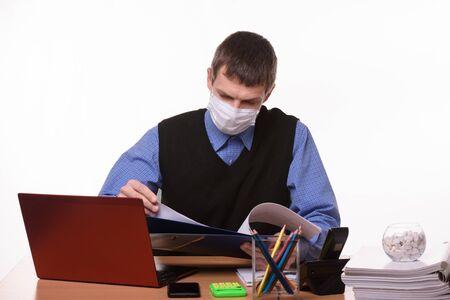 Office clerk leafing through documents in a folder