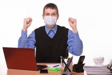 Office specialist in medical mask joyfully celebrates success