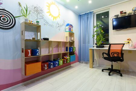 Interior of a teenage children's room with shelves on the wall