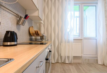 View of the kitchen and exit to the balcony in the background