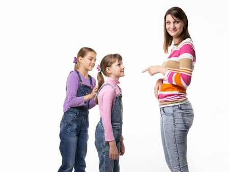 The girl begs the toy from her mother, mother wearily points a finger at the child