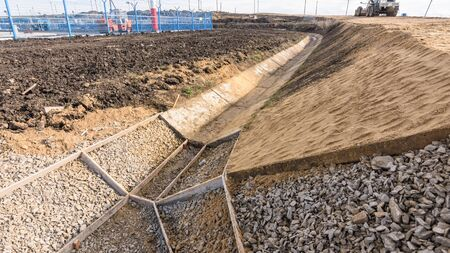 Strengthening the slope and constructing a drainage ditch along the road