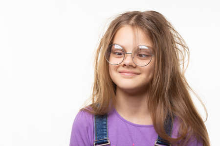 Girl with glasses trying to look at her nose.