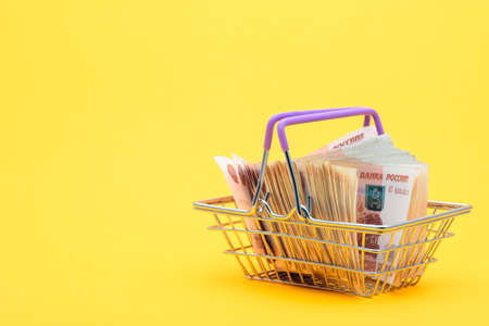 In the grocery cart are Russian banknotes of five thousand rubles Reklamní fotografie