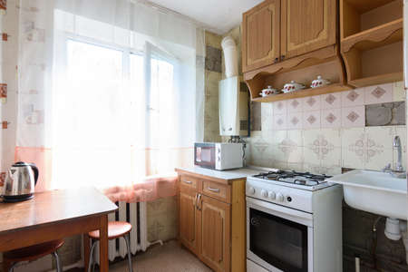 Anapa, Russia - June 25, 2020: Old kitchen in a small apartment requiring major renovation