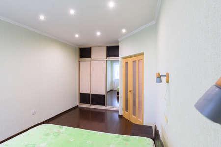 Bedroom interior, large built-in wardrobe, front door 免版税图像
