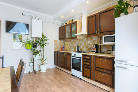 Kitchen set in a spacious living room and kitchen with an old classic wood design Banque d'images