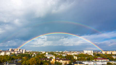 Double rainbow in the sky over the roofs of the resort city of Anapa, Russia 版權商用圖片