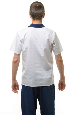 A man in a medical shirt and pants, a view from the back