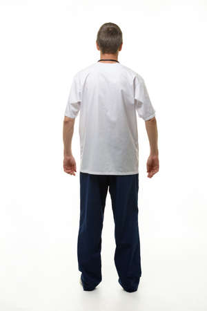 Man showing doctor's clothes, back view, isolated on white background