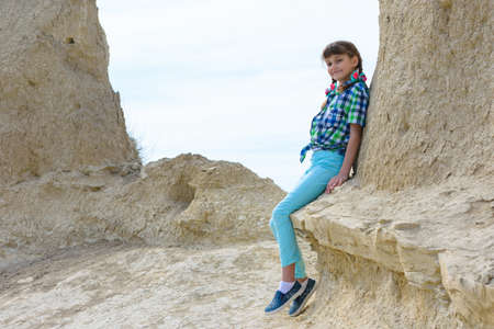 A ten-year-old girl sat down on a rock ledge