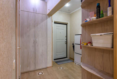 Interior of a classic hallway room with a large wardrobe in a studio apartment