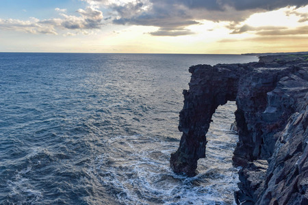 Hōlei Sea Arch is a 90-foot-high natural arch located in Hawaii, on the southern coast of the Big Island, south of Kīlauea.