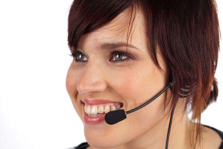 Sch�ne junge Frau Telefonistin auf wei�em hintergrund isoliert