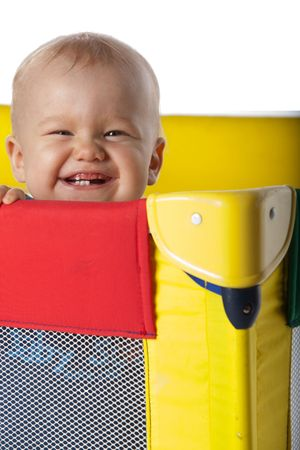 Happy Baby Laughing in Colorful Travelling Cot