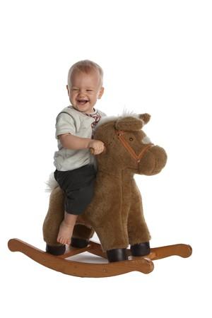 rocking horse: Little Smiling Baby Boy on Rocking Horse